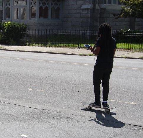 Image of Milan Using Skateboard as Dolly