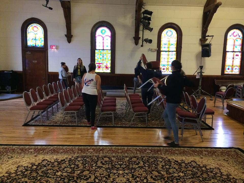 Image of Setting Up Chairs at the Sanctuary
