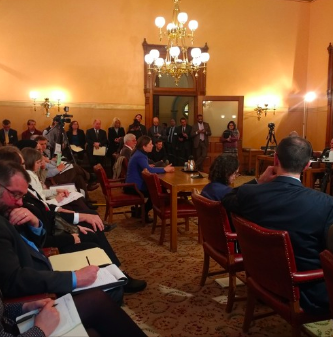 we conclude with testimonies urging legislators to go further to address climate change, including comments from a member of the Intergovernmental Panel on Climate Change.